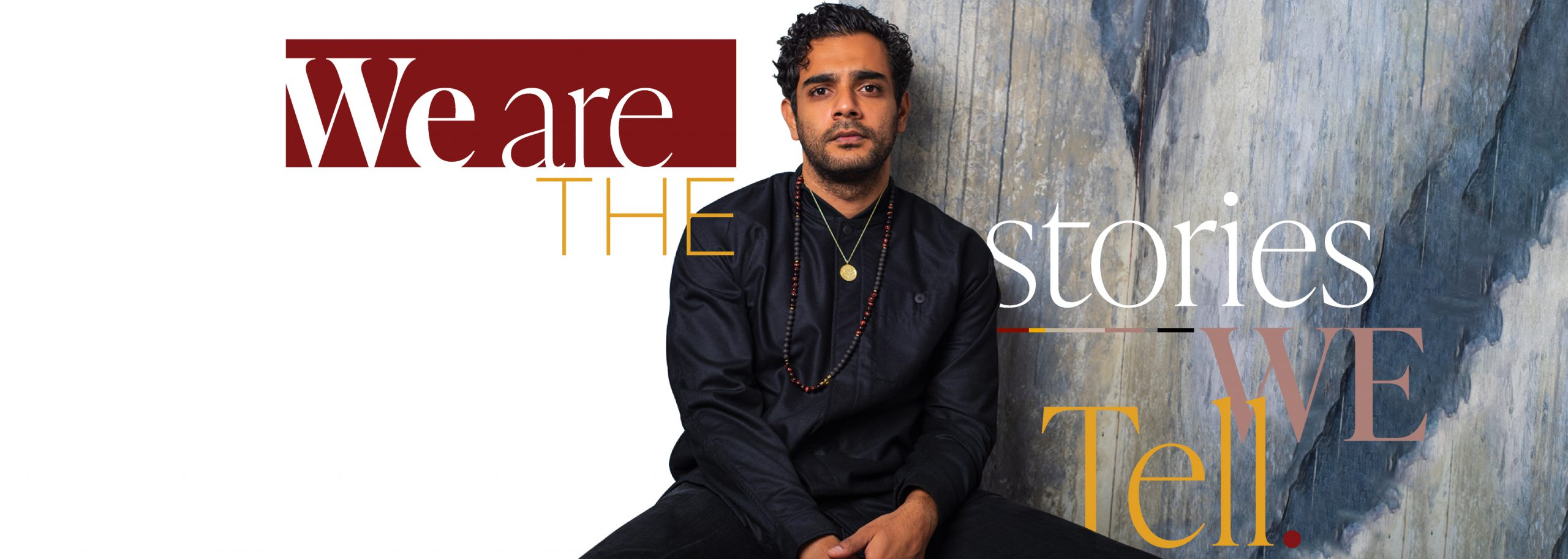 """Hamza Haq in our portrait studio. Surrounded by the saying """"We are the stories we tell."""""""